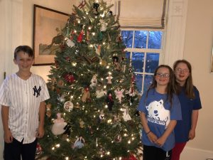 becker family in front of Christmas tree