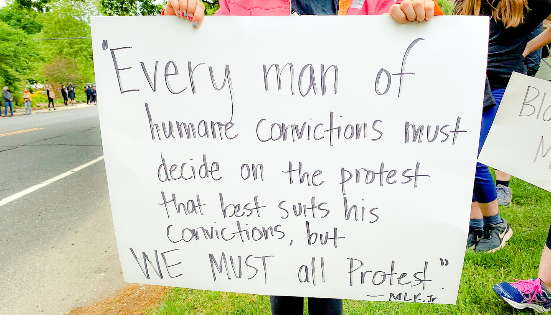 holding sign at protest