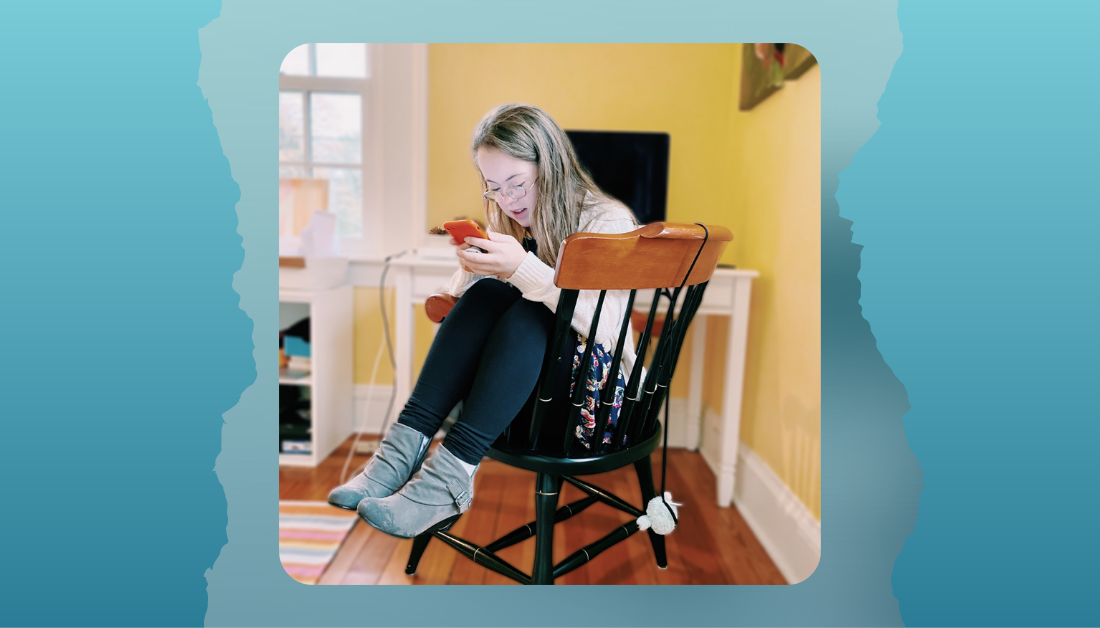 picture of a teenager sitting in a chair texting