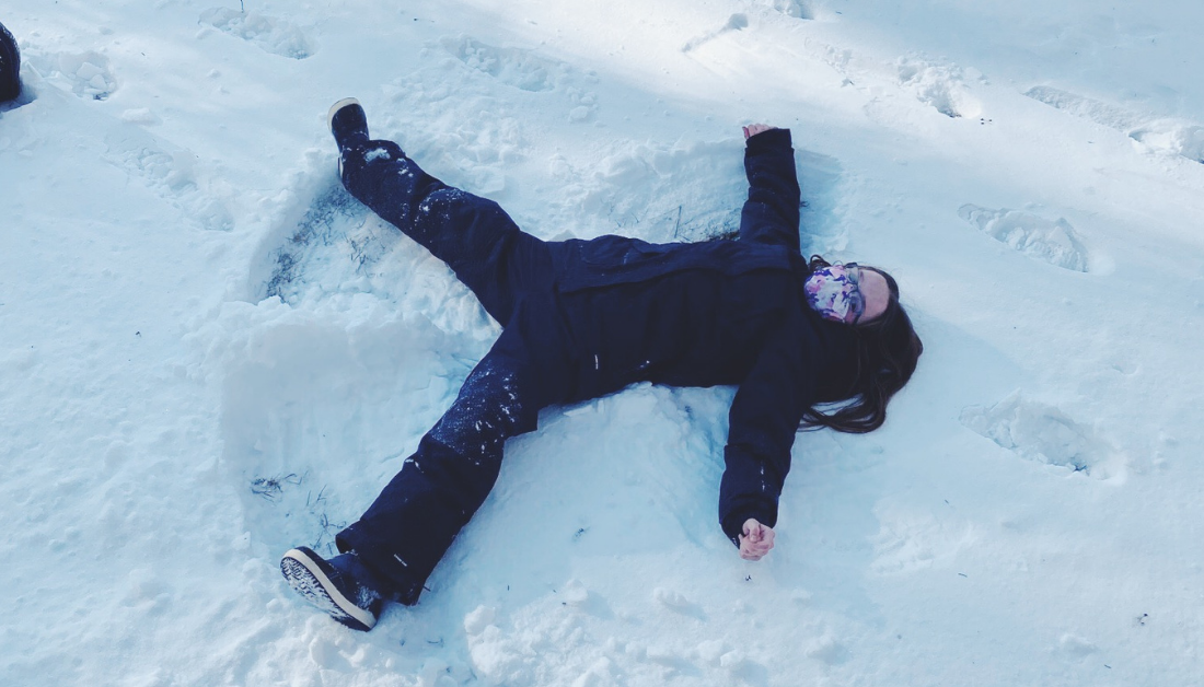 10-year-old girl making snow angel