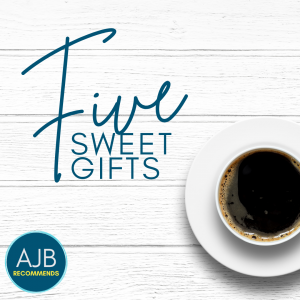 AJB Recommends five sweet gifts text overlay on a picture of a white cup with coffee on a white plank surface