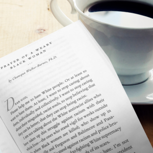 picture of cup of coffee and a page of a book that starts with Dear God, please help me to hate