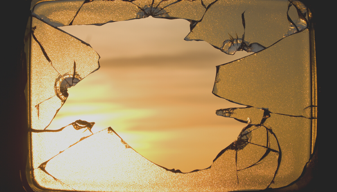 picture of a sunrise seen through broken glass