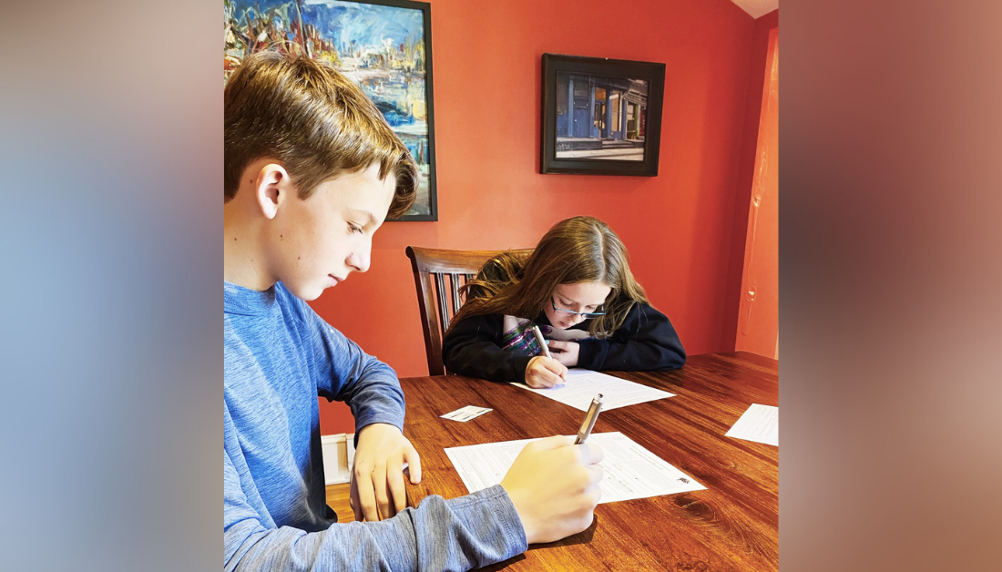 picture of William and Marilee sitting at the table filling out forms