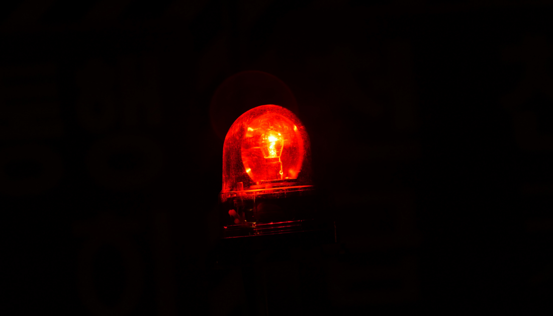 picture of a black background with a red flashing light