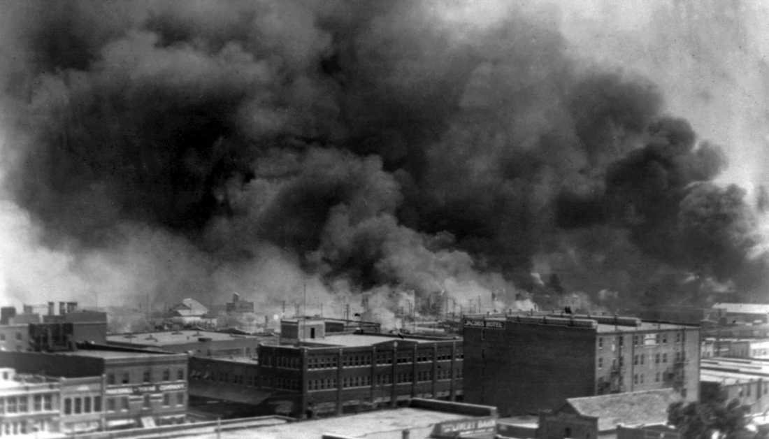 picture of building burning during the Tulsa Massacre in 1921