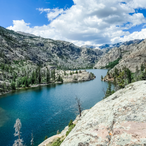 picture of a lake surrounded by trees and mountains