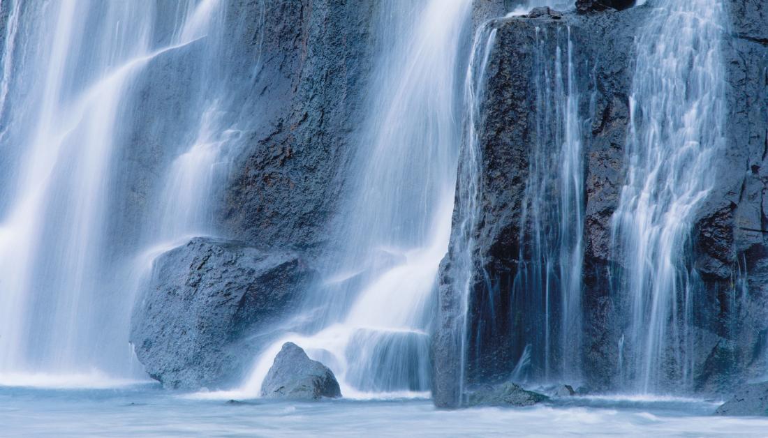 waterfall flowing into a pool below