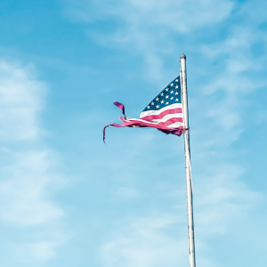 tattered flag depicting the resilience of love that is stronger than fear after 9/11