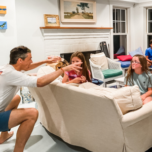 family and friends sitting in the living room playing the Name Game