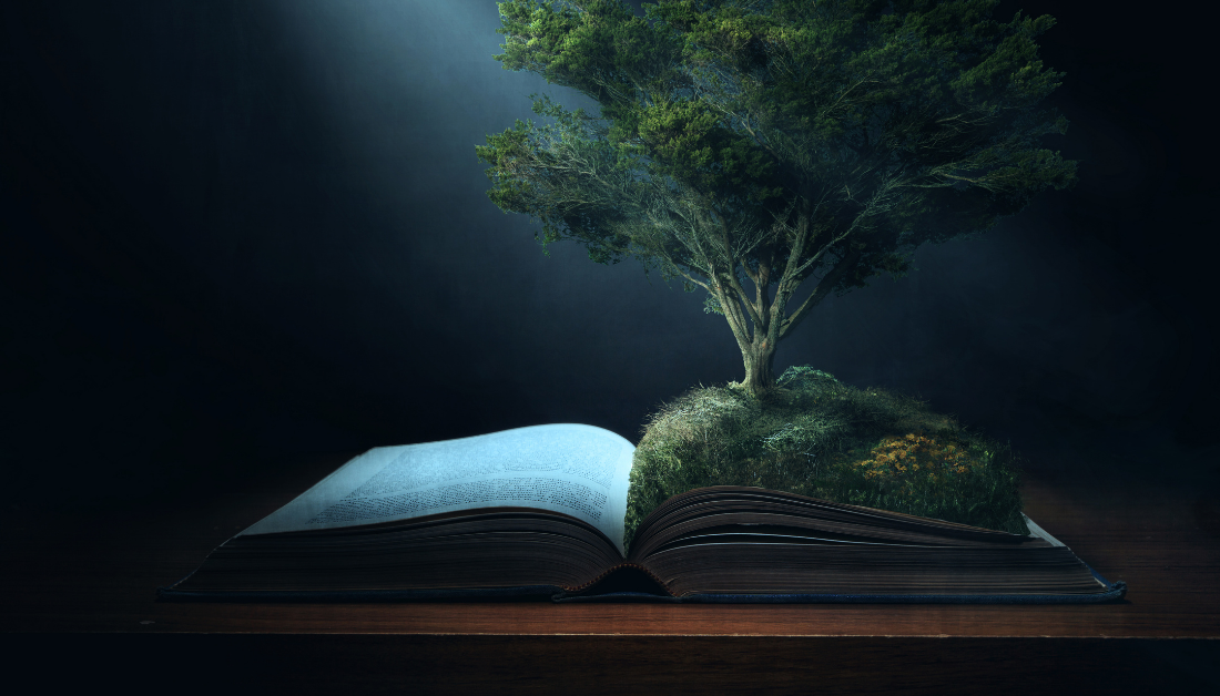 large tree grows out of the pages of the Bible