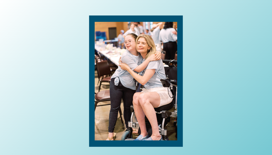 gradient blue graphic with a picture of Penny and Katherine Wolf, who is sitting in a wheelchair, giving each other a hug
