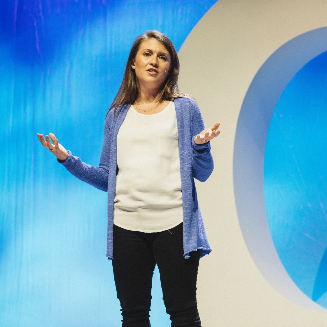 Amy Julia speaking at an event